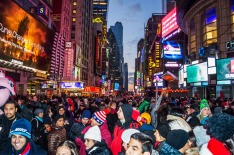 New York, NY, USA - December 31, 2014: Crowds of people gathering in Times Square hours before midnight on New Years ...