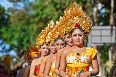 Denpasar, Bali Island, Indonesia - June 11, 2016: Group of Balinese people. Beautiful dancer women in traditional ...