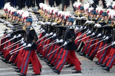 PARIS, FRANCE - JULY 14: Military parades march past members of the government at the ceremony of Bastille Day on the ...