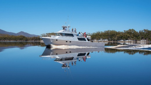 The Odalisque cruising the mirrored waters of Bathurst Harbour.