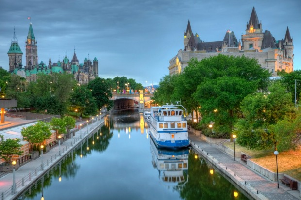 Parliament Hill along the banks of the Rideau Canal in Ottawa Ontario.