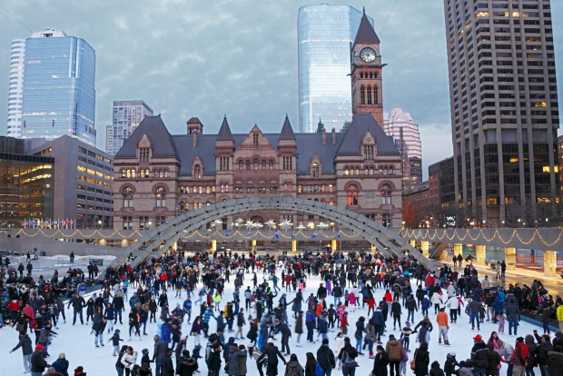 Ice-skating in Toronto's Nathan Phillips Square.