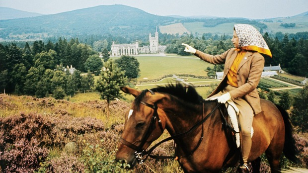 The Queen looking towards Balmoral Castle during the royal family's summer holiday in 1971.
