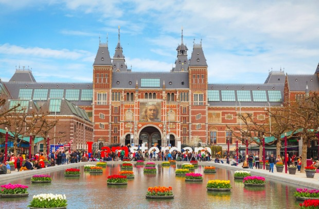 The Rijksmuseum on Museumplein, Amsterdam, Netherlands. The Rijksmuseum, which showcases Dutch art from the past 800 ...
