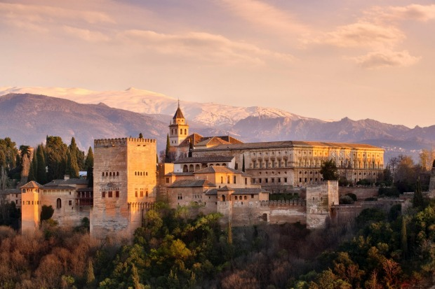 The Alhambra in Granada, southern Spain. Alhambra, perched high above the city of Granada, remains a portal where you ...