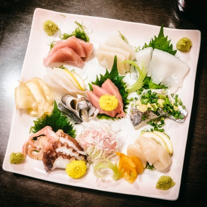 A top-down view of a traditional Japanese sashimi plate.