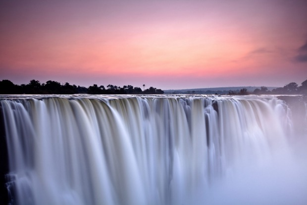 VICTORIA FALLS, AFRICA. Considered the largest waterfall on earth, the 1700-metre-wide wall of water is power ...