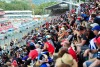 Hear the roar of supercars from the grandstand.