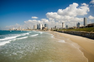 Warmth welcome: The beach and skyline at Tel Aviv.