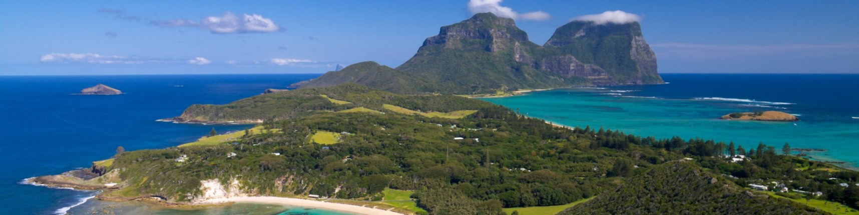 View south over the stunningly beautiful Lord Howe Island from Malabar lookout. Lagoons on both sides of the island are ...