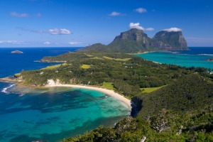 View south over Lord Howe Island with the peaks of Mount Lidgbird and Mount Gower in the distance.