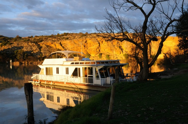 A houseboat moored on the River Murray at Walker Flat, South Australia at sunset.