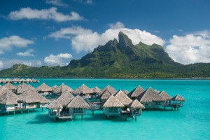 SatFeb25cover Nowhere on Earth best captures the magic of the overwater bungalow than the St Regis Bora Bora Resort - ...