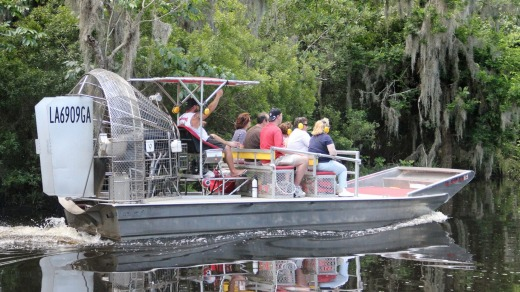 Small airboat moving through the swamps of New Orleans.