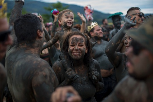 "Revellers enjoy the traditional ""Bloco da Lama"" or ""Mud Street"" carnival party, in Paraty, Brazil. Legend has it the ..."