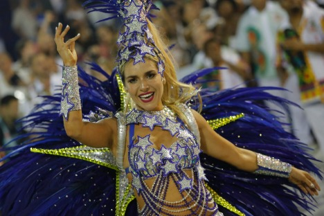 A performer from the Academicos do Grande Rio samba school parades during Carnival celebrations at the Sambadrome in Rio ...