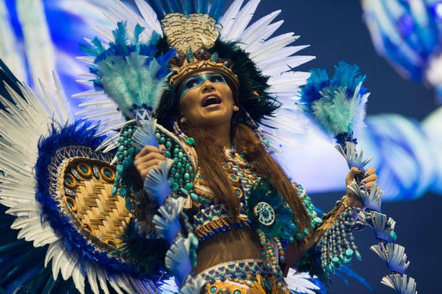A performer from the Beija Flor samba school parades during Carnival celebrations at the Sambadrome in Rio de Janeiro, ...