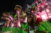 Performers from the Paraiso do Tuiuti samba school parade on a float during Carnival celebrations at the Sambadrome in ...