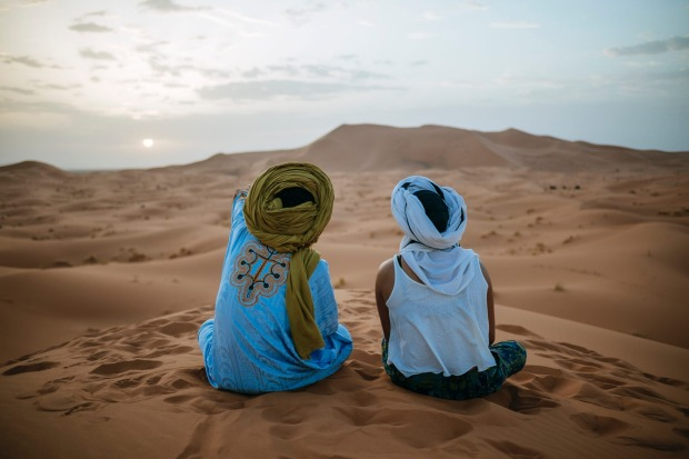 Morocco is a mosaic of exotic experiences. Taking in the majestic desert sunset with a Berber guide.