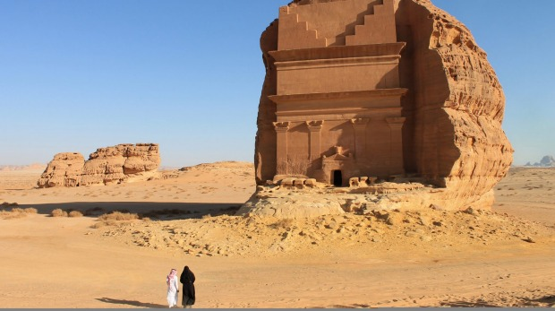 Birgit Mitchell, an American tourist, right, visits Mada'in Saleh, a UNESCO World Heritage Site, with her guide in ...
