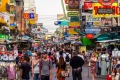 People walking along the busy streets of Khao San Road in Bangkok, Thailand.