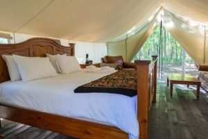 Luxurious furniture in a glamping tent in the woods.