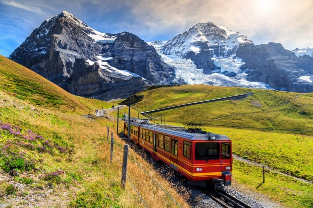 The train coming down from Jungfraujoch station (the 'top of Europe') in Kleine Scheidegg, Bernese Oberland, Switzerland.