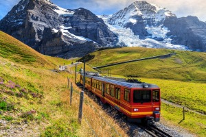 Famous electric red tourist train coming down from the Jungfraujoch station (top of Europe) in Switzerland.