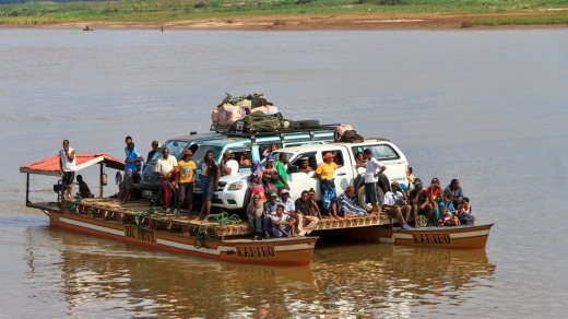 Tourists with their off road vehicle and locals take the ferry during an excursion in Belo Tsiribihina.