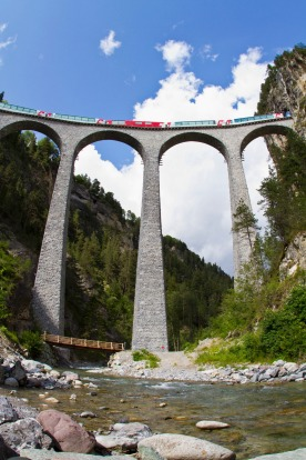 The Glacier Express crossing the Landwasser Viaduct near Filisur, Graubuenden, Switzerland.