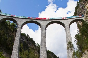 Glacier Express crossing the Landwasser Viaduct near Filisur, Graubuenden.