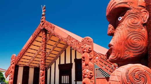 Wood carving outside of Te Papaiouru Marae, a Maori meeting house in Rotorua.