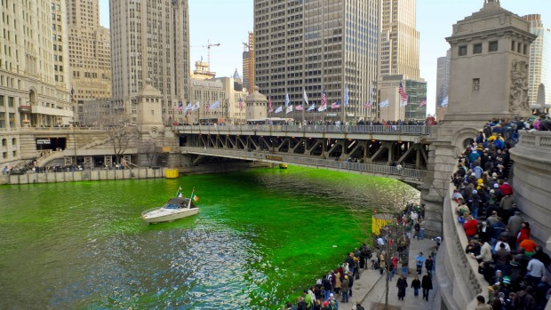 Spectators gather for the greening of the river in downtown Chicago.