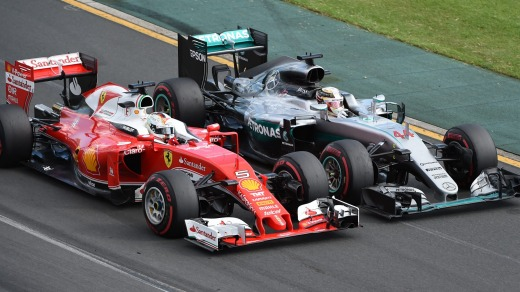 Ferrari driver Sebastian Vettel, left, of Germany and Mercedes driver Lewis Hamilton of Britain race side by side during ...