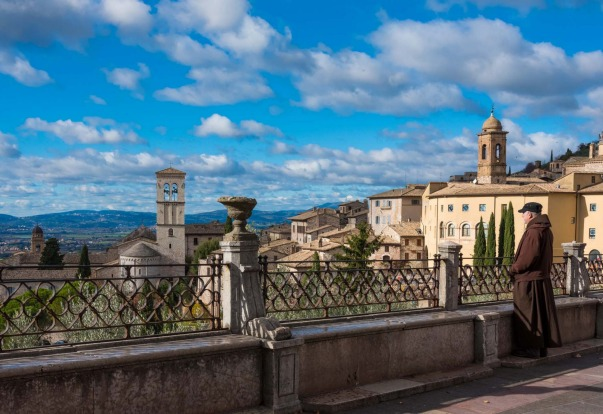 Contemplating the sweeping views of the surrounding countryside in Assisi, Italy.