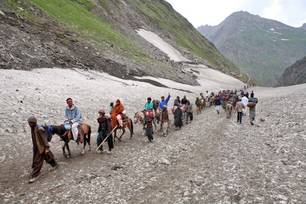 Pilgrimage to the holy Amarnath cave in Jammu and Kashmir in the Indian Himalayas. Amarnath is dedicated to Shiva.