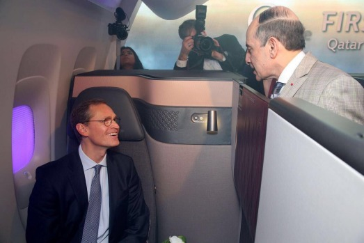 Qatar Airways chief executive, Mr. Akbar Al Baker (right) at the unveiling of he new QSuite in Berlin.