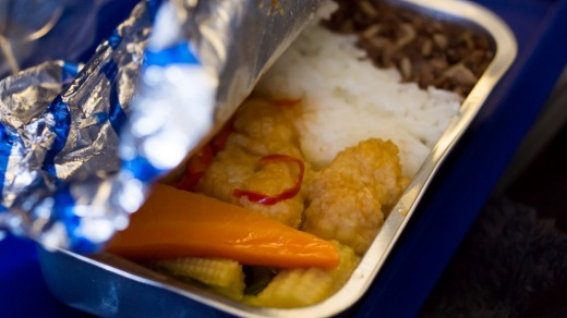Cooped-up: You're flying to get somewhere, which is why some airlines serve meals almost grudgingly.