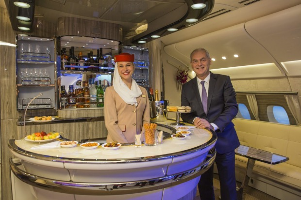 Thierry Antinori, chief commercial officer for Emirates Airlines, right, stands in the new bar area for the A380 ...