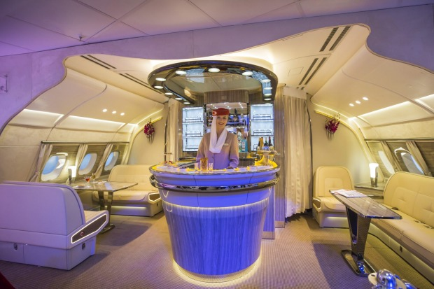 An Emirates Airlines cabin crew attendant stands in the new bar area for the Airbus A380 aircraft.