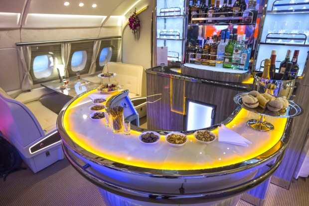The new bar area for the Emirates Airlines A380 aircraft sits on display as it is unveiled to the trade and media during ...