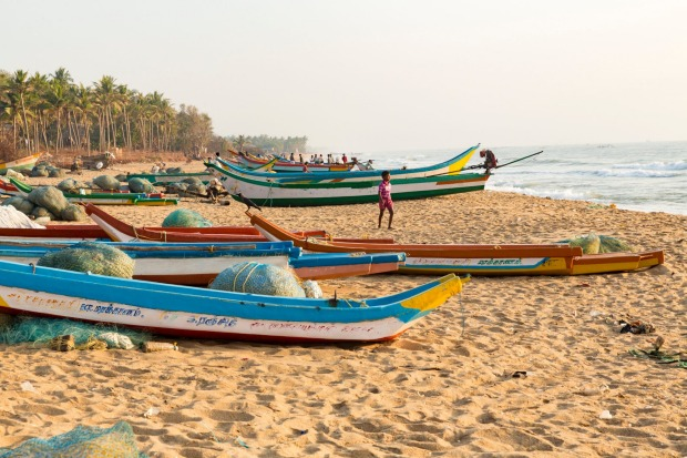 Traditional fishermen with their long boats, Tamil Nadu and Kerala.