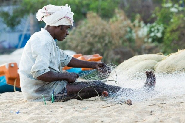 A fisherman tending to his nets.