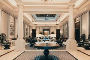 The colonnaded entrance at The Strand, Yangon: A splendid lobby of great size and elegance while unashamedly reminiscent ...