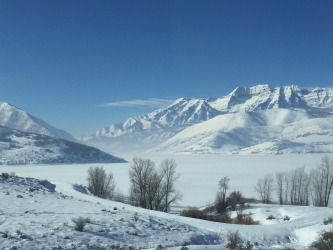 Fresh snow on the Jordanelle Reservoir looking towards the Wasatch Range while leaving Park City on the 248 highway ...