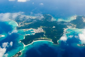 Aerial view of tropical coral islands surrounded by clear blue water, Kerama Islands, Okinawa.