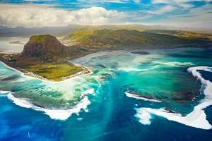 "The amazing ""underwater waterfall"" effect can be seen from the air looking back towards Le Morne."