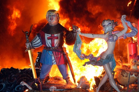A ninot representing U.S. President Donald Trump burns on the last night of the Fallas Festival in Valencia, Spain, ...