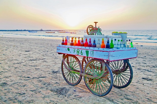 India slush ice street vendors cart hoping to do some trade before the end of a day on the beach at Manori, India.