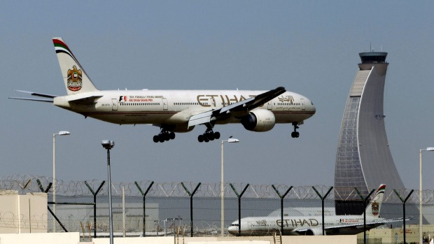 Is Etihad Airways liable to pay compensation if a flight has been delayed due to heavy storm?